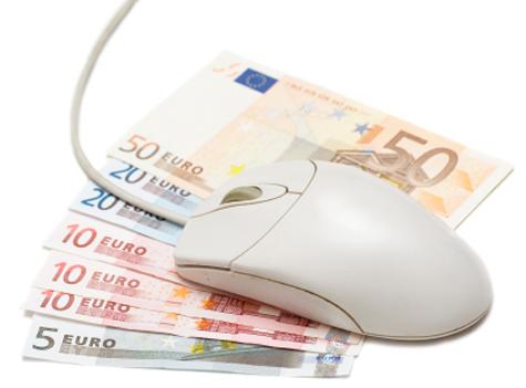 Ratón de ordenador y billetes